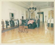 President Kennedy's body lying in repose in the East Room of the White House.