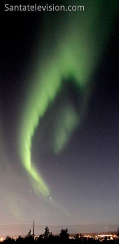 Northern lights (Aurora Borealis) in the sky above Rovaniemi city, Lapland in Finland.