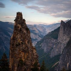 Photo by @jimmy_chin Table top for two on one of the Cathedral Spires in the heart of Yosemite Valley. Although diminutive among the surrounding giant walls, the spires have their own special appeal for climbers.