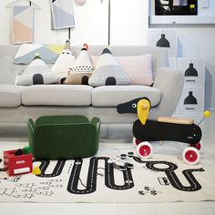 One for the kids room: featuring OYOY adventure rug and tee pee cushions, brio daschund and blocks, muuto restore basket.