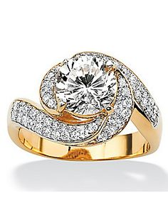 We love the bling in this gold ring! This is different and very pretty