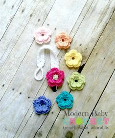 Crochet Baby Changing Flower Pacifier Clip Holder. Includes 7 flowers. $20. Available in all colors. Crochet Pacifier Clip, Pacifier Clips, Pacifier Holder, Binky, Crochet Craft Fair, Crochet Crafts, Crochet Projects, Knitting Patterns, Embroidery