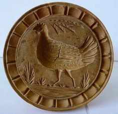 "This rare 19th century round lathe turned butter stamp with a peafowl hen design was found in New England. It has a screw in handle and is missing its outer case. Great patina! No damage or cracks, other than  minor age cracks as would be expected from age and use. No insect damage.  4""h., 2.5""dia.  It is almost identical to the figure V-359 in Kindig's book Butter Prints and Molds p.168.  Offered 10/2/14 on ebay for $395 by hammi."