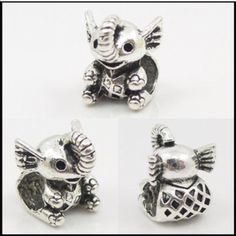 Adorable little elephant charm Cute silver toned charm that will fit Pandora bracelets.This is a cheaper alternative to an authentic Pandora charm but just as cute if not cuter. New without tag.hole is about 5mm Jewelry