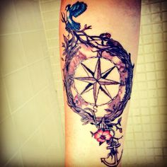 Compass tattoo finished, black and white with color splash