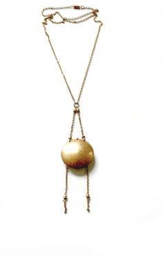 Laura Lombardi Necklace with brass clamshell pendant and beaded fringe detail $50