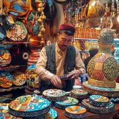 """""""Dup art #uighur #painter #dup #dabazar #urumqi #china #painting #drums #music #instruments #colorful #authentic #culture #market #art #travel #xinjiang"""""""