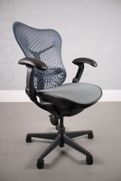 Herman Miller Mirra chair  Specification: Fully loaded chair with all options  Height adjustable using 2 stage gas lift Height adjustable arms Blue back Pivoting arms Vinyl arm pads Graphite frame Carbon (black) pellicle weave Carpet castors (hardwood can be added) Rear tilt limiter Forward tilt Lumbar support    Condition:  chairs have all been refurbished to high standard. Cleaned, re-oiled and parts replaced where needed.  Pieces: Price is for 1 chair although we always have more in stock