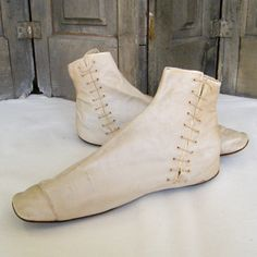 Gaiter Style BootsLinen side laces women's gaiter style boots. Square toe with rounded off corners, leather soles, no heel and original ties. C1830