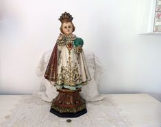 Antique French infant of Prague religious statue 1900s child Jesus Christ figure glass eyes, globe, XL hand painted sculpture, crown