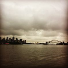 Sydney looking a little moody today #instatravel #travel #globetrotter #straya #australia #sky #traveling #greatsouthernland #straya #travelgram #igtravel #sydneyharbour #sydneyoperahouse #sydneyharbourbridge #instapic #instaphoto #cityscape #thisissydney #thisisaustralia #sydney by paulagalea81 http://ift.tt/1NRMbNv