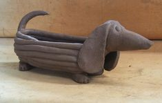 You just never know what will happen when you pick up the clay...! A dachshund pot...a wiener dog classic...!