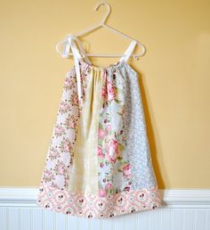 Fat Quarter Pillowcase dress.  I like this tutorial because it has arm holes, but no bias tape. kid-stuff