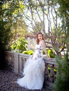 Trumpet / mermaid sleeveless organza floor-length bridal gown