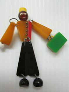 "super cute multicolor Bakelite figural 'bellboy' brooch pin - measures 4"" tall."