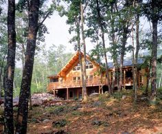 Back of New Hampshire log home in the woods
