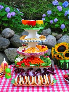 Using a cupcake stand for outdoor food display - this site suggest how to arrange certain foods to make it visually pretty as  well as tasty for your guest!