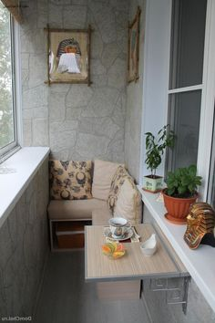 http://www.justsoakit.com/wp-content/uploads/2015/01/stunning-interior-of-small-balcony-with-seating-area-as-well-plant-beside-indoor-glass-window-also-brown-pillow-on-sofa-plus-wooden-coffee-table-446x669.jpg