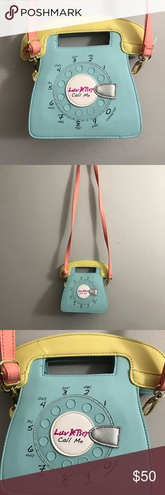 """NWOT - Betsy Johnson call me Luv Betsey Johnson Phone Crossbody Satchel Shoulder Bag Small bag measuring approx 7.5""""L x 9""""H x 2.75"""" Removable, adjustable pink crossbody strap Lined with pink and white striped material with black hearts and stars Betsey Johnson Bags Crossbody Bags"""