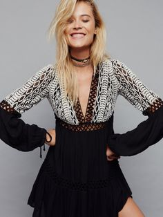Dusk 'Til Dawn Mini   Long sleeve mini dress featuring a gauzy fabrication and pretty tribal-inspired embroidery on the bodice. Deep V-neckline with adjustable tasseled tie closure at the back. Peek-a-boo crochet panels throughout. Drawstring ties on the sleeve cuffs. Lined.