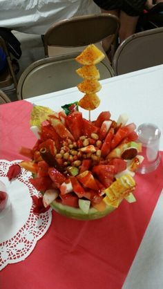 Mexican Fruit filled with melons and candy syrup called Lucas Gusano Chamoy liquid candy!  Watermelon  Cantaloupe  Honey Dew Jicama  Cucumber  Orange Janessse peanuts Lucas Gusano Chamoy