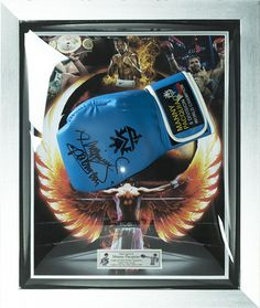 Authentic hand signed Manny Pacquiao MP8 Blue Boxing Glove framed in an acrylic dome display. This glove is the real deal and hand signed by Pacman himself the eight division world champion and arguably the best pound for pound fighter on the planet.