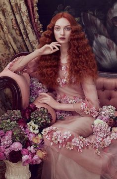 Renaissance style waves are channeled by a redhead model