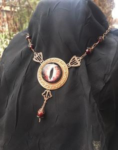 Copper/Bronze Red Dragon Eye Necklace by AestheticAmbrosia on Etsy https://www.etsy.com/listing/259888814/copperbronze-red-dragon-eye-necklace