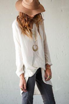 Felt hat, bold necklace, and feminine shirt...
