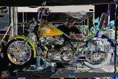 A motorcycle mechanic plies his trade.