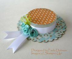 This is a box, made in the form of a hat. Quilling could easily be added to it for an elegant gift box - by: Stampinantics: 3D Projects