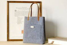 Snap up a timeless gray felt tote, handmade in Italy. #etsygifts #etsy