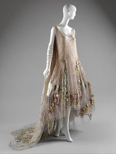 Boué Soeurs circa 1923-1925. This robe de style has a beautiful metallic-embroidered tulle overlay and grey-blue silk insets and clusters of the most exquisite ribbon flowers.