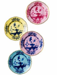 A dreamy tableau embellishes Richard Ginori's Oriente Italiano porcelain. Shown, from top, are dinner plates in the colors porpora, citrino, azalea, and iris; $95 each, $120 with 24K-gold rim, all by special order from Barneys. barneys.com