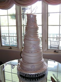 "Topsy Turvy Wedding cake - 3 hours of sleep in 48 hours for this and a groom's cake... who do I think I am???  ugh... turned out this beautiful cake though. Bottom two tiers (14"", 12"") are styro followed by three topsy turvy, hour glass carved tiers. learned a lot. should've used larger tiers than regular topsy turvy scale because the bottom of the hour glass shape is wider than I planned so when I cut the holes I cut away so much cake only fondant was left to hold the angle and it didn't hol..."