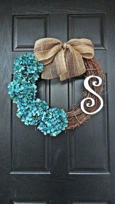 Grapevine wreath with blue hydrangeas & burlap bow.