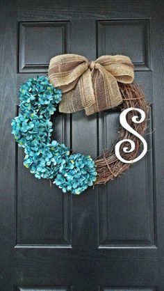 Grapevine wreath with blue hydrangeas & burlap bow.
