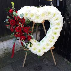 Large Based Open Heart with a red floral spray, sitting on a wooden stand. Florist London, Funeral Tributes, Same Day Flower Delivery, Christmas Wreaths, Floral Wreath, Seasons, Holiday Decor, Heart, Flowers