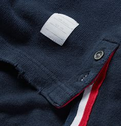 <a href='http://www.mrporter.com/mens/Designers/Thom_Browne'>Thom Browne</a>'s signature polo is intentionally distressed for a rugged look. Made in Japan from soft cotton-jersey, this piece has a slim fit and is trimmed with the brand's iconic tricolour striping on the chest pocket. Wear yours with sandy chinos and a blazer.