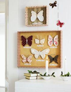 Un tableau de papillons réalisés en bouts de tissus à motifs ou à fleurs