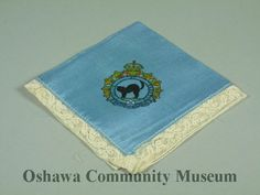 008.8.50a-c, Handkerchief featuring the Ontario Regiment crest.  Fidelis et Paratus is the motto of the Ontario Regiment, a primary reserve of the Royal Canadian Armoured Corps (RCAC), which has its headquarters in Oshawa. Fidelis et Paratus translates to Faithful and Prepared.