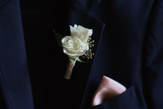 White spray rose boutonniere by  Design House Weddings.