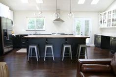 Not such a fan of the modern style, but adore the airy-ness of the white cabinetry + darker wood floors & cabinets.