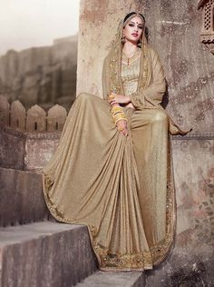 Golden designer saree with handwork, mirror work and gota blouse