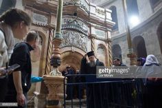 People visit The tomb of Jesus Christ with the rotunda is seen in the Church of the Holy Sepulchre on March 21 2017 in Jerusalem Israel The tomb of... Jesus Tomb, Jesus Christ, Stock Pictures, Stock Photos, Holy Land, Royalty Free Photos, Jerusalem Israel, March 21, People