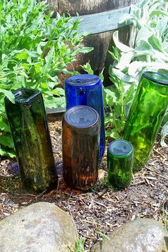 Love the way these bottles are in the garden, just a small colorful display.