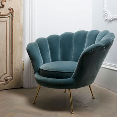 Un fauteuil e, forme de coquillag