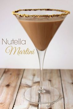 Nutella Martini [Dip martini glass in Nutella and then crushed graham crackers; Mix 3/4 c ice cream, 1/4 c Nutella, 1 shot milk, 1 shot vodka in blender; Pour into martini glass]