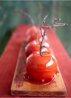 The most festive looking toffee apples ever... not sure if those twigs will hold up whilst the apple is being eaten though...?