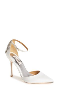 """Free shipping and returns on Badgley Mischka 'Gem' Pointy Toe Satin Pump (Women) at Nordstrom.com. An exquisite white-satin d'Orsay pump is elevated by the sparkling mosaic of crystals that details the heel. An extra-special blue teardrop crystal stands ready and waiting to be your """"something blue."""""""
